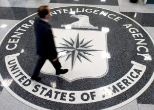 "A man walks over the seal of the Central Intelligence Agency (CIA) in the lobby of CIA Headquarters in Langley, Virginia, on August 14, 2008. Gen. Michael Hayden, who was replaced as CIA chief earlier this year by President Barack Obama, assailed Obama's decision last week to release ""Top Secret"" memos detailing the interrogation techniques as ""really dangerous"" for US intelligence efforts. Speaking on the ""Fox News Sunday"" program, on April 19, 2009 Hayden rejected claims by critics that methods like extreme sleep deprivation, waterboarding and the use of insects to provoke fear had proved ineffective in getting information from top members of the Al-Qaeda terrorist network. AFP PHOTO/SAUL LOEB/FILES"