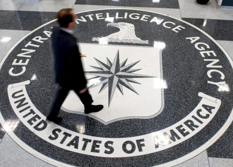 """A man walks over the seal of the Central Intelligence Agency (CIA) in the lobby of CIA Headquarters in Langley, Virginia, on August 14, 2008. Gen. Michael Hayden, who was replaced as CIA chief earlier this year by President Barack Obama, assailed Obama's decision last week to release """"Top Secret"""" memos detailing the interrogation techniques as """"really dangerous"""" for US intelligence efforts. Speaking on the """"Fox News Sunday"""" program, on April 19, 2009 Hayden rejected claims by critics that methods like extreme sleep deprivation, waterboarding and the use of insects to provoke fear had proved ineffective in getting information from top members of the Al-Qaeda terrorist network. AFP PHOTO/SAUL LOEB/FILES"""