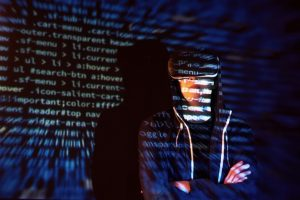 cyber-attack-with-unrecognizable-hooded-hacker-using-virtual-reality-digital-glitch-effect_146671-18954