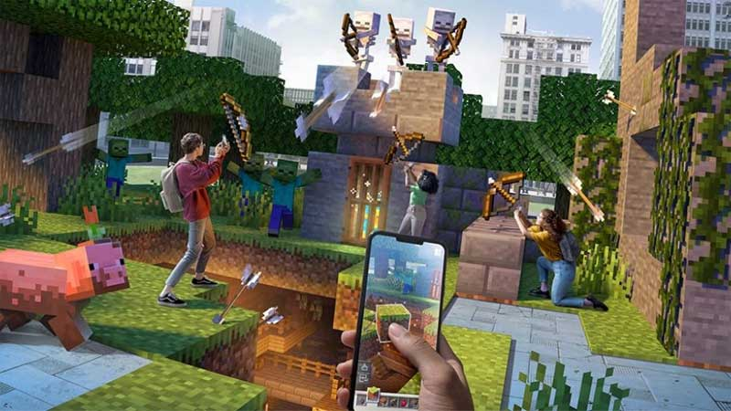 A hand holds a mobile phone with a thumb placed on it at the bottom of an image displaying a vast Minecraft cyberscape, Minecraft blocks spread across with numerous players arrayed across battlements fighting skeletons, shooting arrows, firing spells, fending them off in a grand augmented reality adventure!